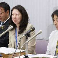 The Bank of Japan's Nagoya branch manager Tokiko Shimizu (center) speaks at a news conference on Thursday, while Sapporo branch manager Sho Kotaka (right) sits next to her, at the BOJ's headquarters in Tokyo. | KYODO