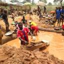 In this photograph taken on April 4, gold miners work at a mining site in the Cameroon town of Betare Oya.