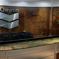 The logo of Chevron is seen at the company's office in Caracas Wednesday. | REUTERS