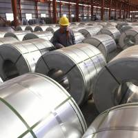 A factory worker checks rolls of aluminum in Zouping County in east China's Shandong province on April 7.   AP