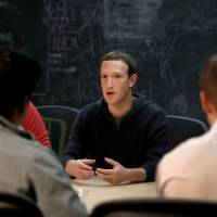 Facebook CEO Mark Zuckerberg meets with a group of entrepreneurs and innovators during a round-table discussion at Cortex Innovation Community technology hub in St. Louis last November. Facebook said Wednesday that it has shut down a feature that let people search for Facebook users if they had their phone number or email address. In a call with reporters on Wednesday, Zuckerberg said the company had tried 'rate limiting' the searches. | AP