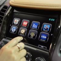 An attendee demonstrates the OnStar 4G LTE dash system on a Chevrolet Impala in Detroit on Jan. 13, 2014. | BLOOMBERG