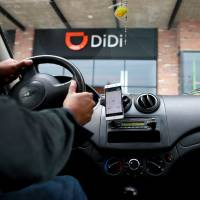 A new driver's mobile phone is seen with the app of Chinese ride-hailing firm Didi, outside the new drivers center in Toluca, Mexico,on Monday. | REUTERS