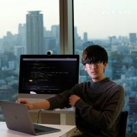 Ryo Fukuda, a software engineer at Next Currency Inc., is seen at the company's headquarters in Tokyo on March 30 | REUTERS