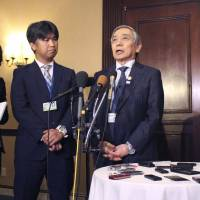 Bank of Japan Gov. Haruhiko Kuroda speaks to the media Thursday in Washington ahead of the opening of the Group of 20 meeting of finance chiefs. | KYODO