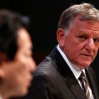 Volkswagen Truck & Bus GmbH CEO Andreas Renschler (right) and Hino Motors President Yoshio Shimo attend a joint news conference in Tokyo on Thursday. | REUTERS