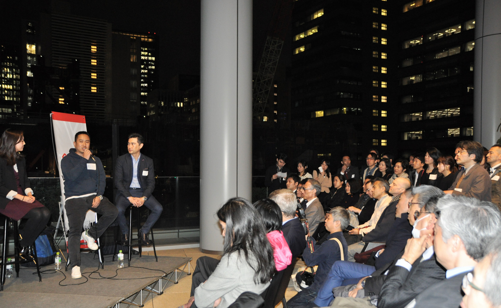 Panelists speak at the launch of Venture Cafe Tokyo, an organization promoting innovation, at the Toranomon Hills complex in the capital, on March 22. | KYODO
