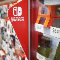 Pre-owned Nintendo Co. DS handheld video game consoles are displayed inside a GameStop Corp. store in Louisville, Kentucky, on March 15. | BLOOMBERG