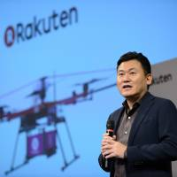 Hiroshi Mikitani, chairman and chief executive officer of Rakuten Inc., speaks during a news conference in Tokyo in October. | BLOOMBERG
