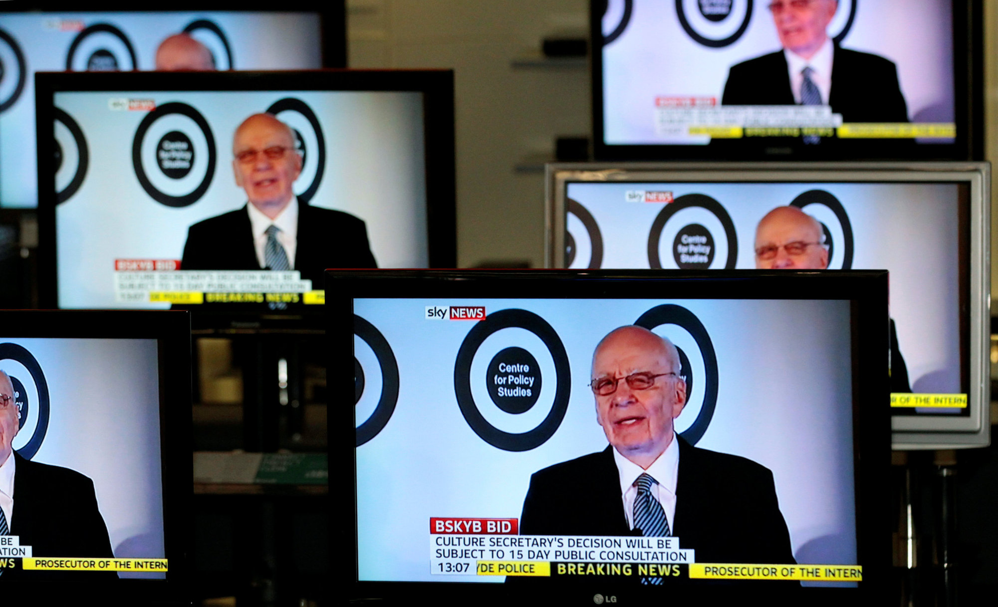 Executive Chairman of News Corporation and Executive Co-Chairman of Twenty-First Century Fox Rupert Murdoch is seen talking on Sky News on television screens in an electrical store in Edinburgh, Scotland, Tuesday. | REUTERS