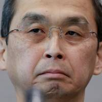 Takata Corp. CEO Shigehisa Takada listens to a reporter's question during a news conference in Tokyo on June 26. | AP