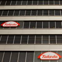 Logos of Takeda Pharmaceutical Co. are seen at an office building in the Glattbrugg area near Zurich in March 2012. | REUTERS