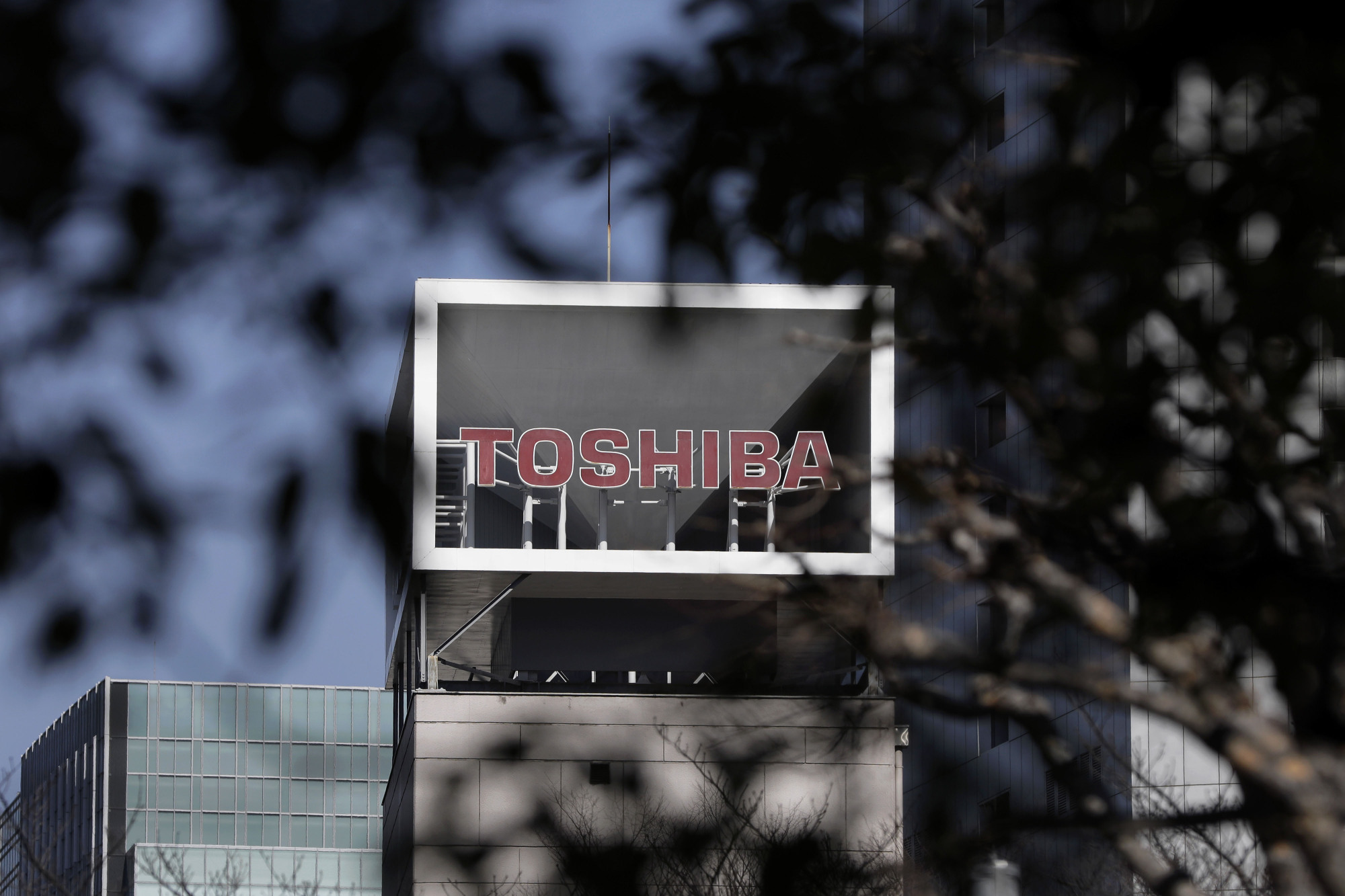 Toshiba Corp. is likely to miss a May 1 deadline to sell its memory chip business to a Bain Capital-led group. | BLOOMBERG