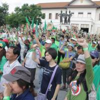 Thais rally against officials building homes on sacred mountain in Chiang Mai