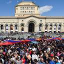 Opposition supporters carrying a giant Armenian flag attend a rally Tuesday in downtown Yerevan to commemorate the 103rd anniversary of the massacre of 1.5 million Armenians by Ottoman forces.