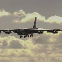 A U.S. Air Force B-52 bomber lands at Andersen Air Force Base in Guam in January. | U.S. AIR FORCE