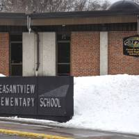 A sign marks one of the entrances to Pleasantview Elementary School on Monday in Sauk Rapids, Minnesota. Authorities say an 8-year-old student took a kitchen knife to the central Minnesota elementary school and attacked three other children on Monday. | DAVE SCHWARZ / ST. CLOUD TIMES / VIA AP