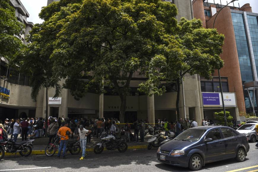 Venezuelans swarm outside Chilean Consulate seeking new visa and home