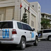 A United Nations vehicle is seen outside the hotel where the international experts from the Organization for the Prohibition of Chemical Weapons (OPCW) are staying in Damascus on Friday. | AFP-JIJI