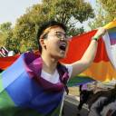 An LGBT group leads more than 100 people in joining a large marathon on Sunday in the city of Nanjing to raise awareness of LGBT issues.