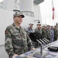 Chinese President Xi Jinping attends a naval review Thursday in the South China Sea. | XINHUA NEW AGENCY/ VIA KYODO