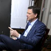 ABC News correspondent George Stephanopoulos (left) appears with former FBI Director James Comey for a taped interview that aired during a prime-time '20/20' special on Sunday. Comey's book, 'A Higher Loyalty: Truth, Lies, and Leadership,' will be released Tuesday. | AP