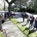 Members of the U.S. State Department hold a tarp to cover a locksmith working to gain access to the former residence of the Russian consul general as media and Russian Consular officials watch in Seattle Wednesday.