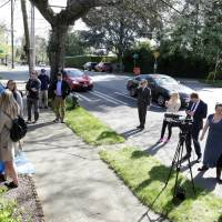 U.S. officials drill out locks, inspect Russian consular home in Seattle