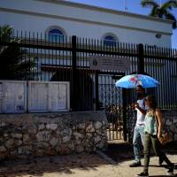 People pass by the Canadaian Embassy in Havana, Cuba, on Monday.   REUTERS