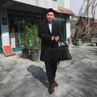Joo Seung Hyeon, a North Korean defector, stands outside a cafe in Seoul on March 26. | AFP-JIJI