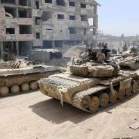 Rebel fighters, and hostages, begin leaving Syria's besieged Douma after weeks of bombardments