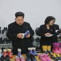 North Korean leader Kim Jong Un visits the Ryuwon Shoe Factory in Pyongyang in this photo released on Jan. 21, 2015.   REUTERS