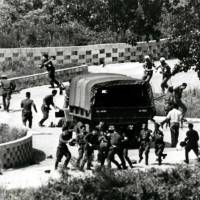 North Korean soldiers attack United Nations Command personnel (wearing helmets) at the truce village of Panmunjom on Aug. 18, 1976. The village inside the Demilitarized Zone was created at the close of the 1950-53 Korean War. Bloodshed and gunfire have occasionally occurred here, but it has also been a venue for numerous talks. | AP