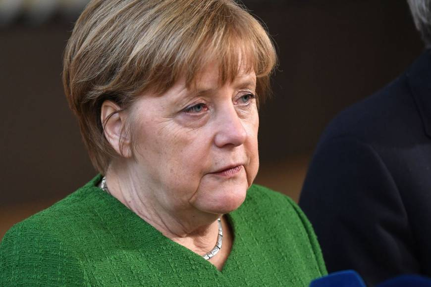 Immigration row overshadows start of German Chancellor Angela Merkel's fourth term