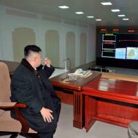 North Korean leader Kim Jong Un smokes a cigarette at the General Satellite Control and Command Center following the launch of the Unha-3 rocket at West Sea Satellite Launch Site in North Pyongan province in December 2012. | REUTERS
