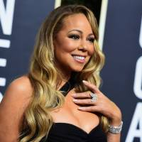 Mariah Carey arrives at the 75th annual Golden Globe Awards at the Beverly Hilton Hotel in Beverly Hills, California, in January. Carey said she's no longer living in isolation after seeking treatment for a bipolar disorder.   JORDAN STRAUSS / INVISION / VIA AP