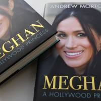 In this arranged photograph, the cover of the book titled 'Meghan, A Hollywood Princess,' by author Andrew Morton, is pictured in London on Friday,. Meghan Markle had her heart set on becoming 'Diana 2.0' from an early age, according to the new biography of Prince Harry's fiancee due out in Britain on Thursday. | AFP-JIJI