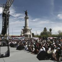 Presidential candidate Andres Manuel Lopez Obrador, with the MORENA party, addresses supporters during his campaign rally in Ciudad Juarez, Mexico, Sunday. Mexico will hold general elections on July 1. | AP