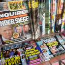 This July 12, 2017, file photo shows the cover of an issue of the National Enquirer featuring President Donald Trump at a store in New York. Karen McDougal, a former Playboy model who said she had a 10-month affair with President Donald Trump, settled her lawsuit Wednesday with a supermarket tabloid over an agreement that prohibited her from discussing the relationship publicly.