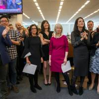 New York Times staff writers (right from third from left) Jodi Kantor, Megan Twohey, senior enterprise editor Rebecca Corbett and reporter Cara Buckley celebrate with colleagues in the newsroom after the team they led won the 2018 Pulitzer Prize for Public Service in New York Monday. | COURTESY HIROKO MASUIKE / THE NEW YORK TIMES / HANDOUT / VIA REUTERS