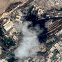 This handout satellite image taken on April 11 and provided on Sunday by Distribution Airbus DS shows the Scientific Studies and Research Centre (SSRC) compound in the Barzeh district, north of Damascus, before the raids by the United States, Britain and France. | CNES 2017, DISTRIBUTION AIRBUS DS / HANDOUT / VIA AFP-JIJI