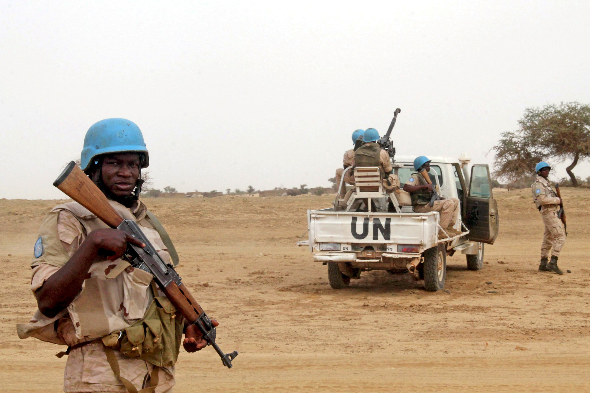 U.N. peacekeepers stand guard in the northern town of Kouroume, Mali, in 2015. Kourome is 18 km (11 miles) south of Timbuktu. | REUTERS