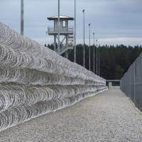 Razor wire protects a perimeter of the Lee Correctional Institution in Bishopville, South Carolina, in this Feb. 9, 2016 file photo. | AP