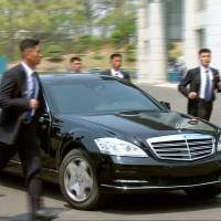 Security personnel accompany a vehicle transporting North Korean leader Kim Jong Un at the inter-Korean summit at the truce village of Panmunjom in this still frame taken from video on Friday. | REUTERS