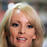 Trump attorney seeks to force porn star's lawsuit into arbitration