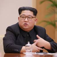 North Korean leader Kim Jong Un heads a party meeting in this photo released Tuesday.   KCNA / VIA REUTERS