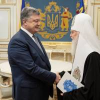 Ukraine moves to split church from Russia as elections approach