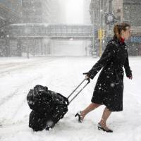 Deadly spring storm keeps central U.S. in icy grip