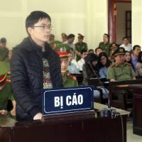 Vietnam jails two more activists in stepped-up crackdown