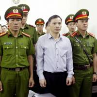 Vietnam hands down harsh jail terms to six activists for advocating a multiparty democracy